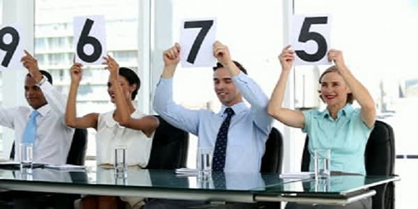 stock-footage-business-people-holding-grades-and-showing-them-in-bright-office